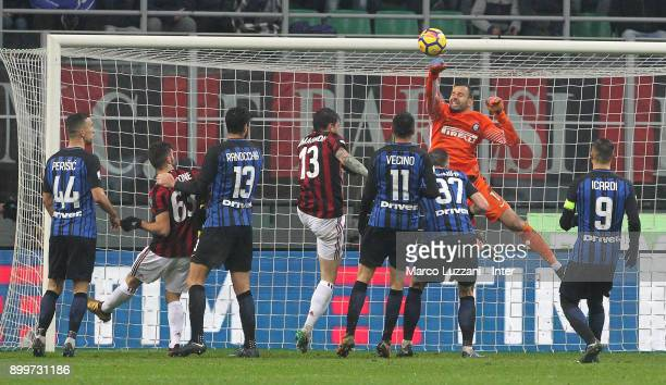 Samir Handanovic of FC Internazionale makes a save during the TIM Cup match between AC Milan and FC Internazionale at Stadio Giuseppe Meazza on...