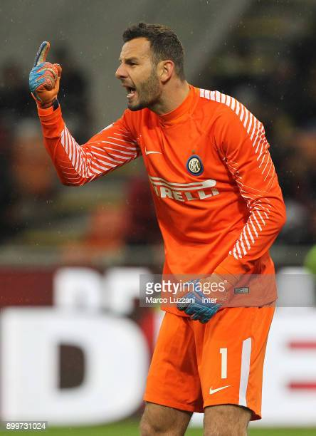 Samir Handanovic of FC Internazionale shouts to his teammates during the TIM Cup match between AC Milan and FC Internazionale at Stadio Giuseppe...