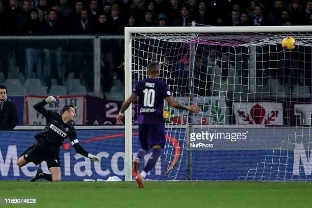 Samir Handanovic of FC Internazionale watches the ball kicked by Dusan Vlahovic of ACF Fiorentina enter the goal during the Serie A match between ACF...