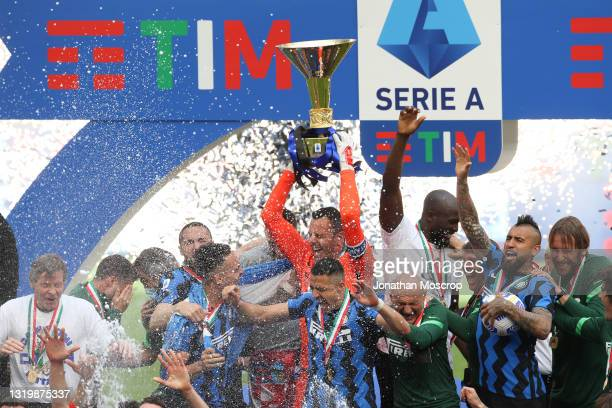 Samir Handanovic of Internazionale lifts the Scudetto trophy following the Serie A match between FC Internazionale Milano and Udinese Calcio at...