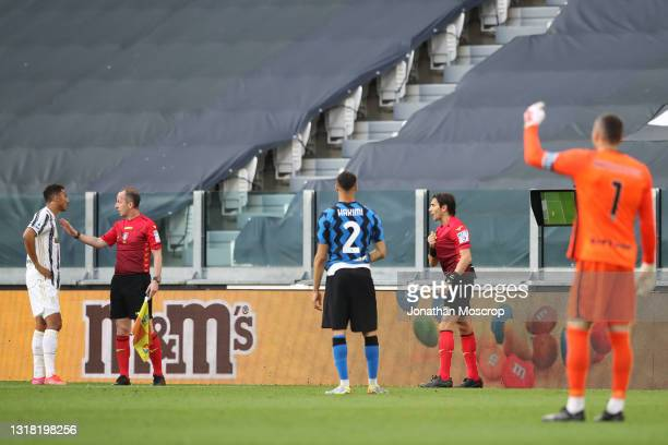 Samir Handanovic of Internazionale looks on as the referee Gianpaolo Calvarese indicates towards Danilo of Juventus that there was some shirt tugging...