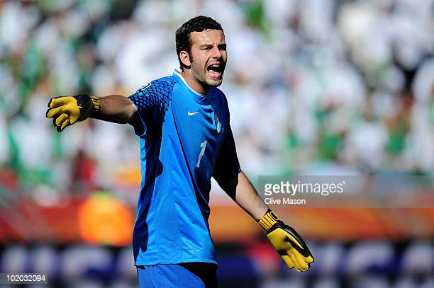 Samir Handanovic of Slovenia calls to team mates during the 2010 FIFA World Cup South Africa Group C match between Algeria and Slovenia at the Peter...