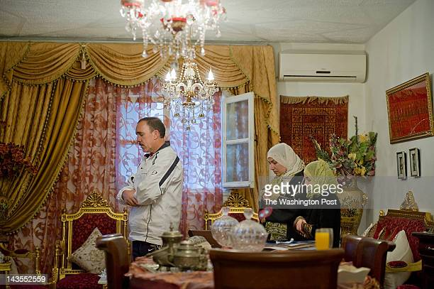 Samir Layouni prays at home with his wife Hela and daughter Noor in Sidi Bou Said Tunisia on Sunday April 15 2012 Layouni a member of the Ennahda...