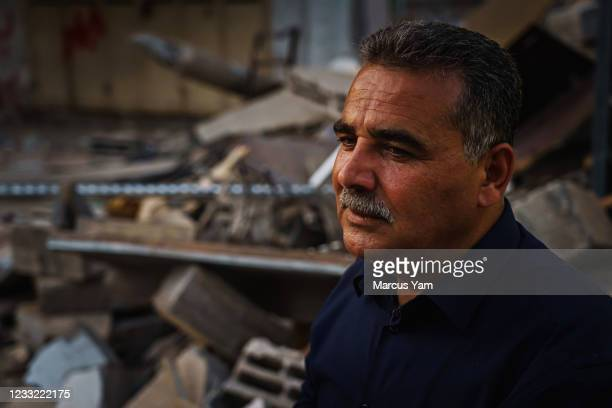 Samir Mansour stands before the remains of his bookstore, a Gaza cultural lodestar, destroyed in an Israeli bombardment during the last escalation...