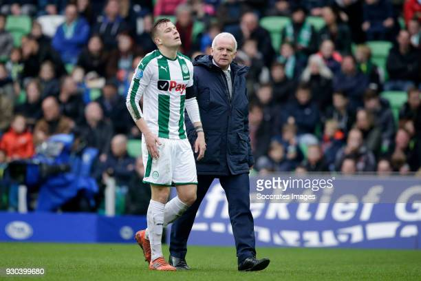 Samir Memisevic of FC Groningen is leaving the pitch injured during the Dutch Eredivisie match between FC Groningen v PEC Zwolle at the NoordLease...