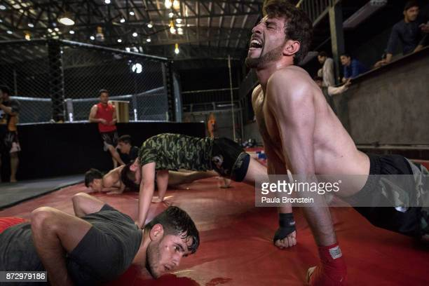 Samir Mukhlis, age 23, trains during MMA tryouts at the Snow Leopard Fighting Championship gym on May 7,2017 in Kabul, Afghanistan. He is considered...