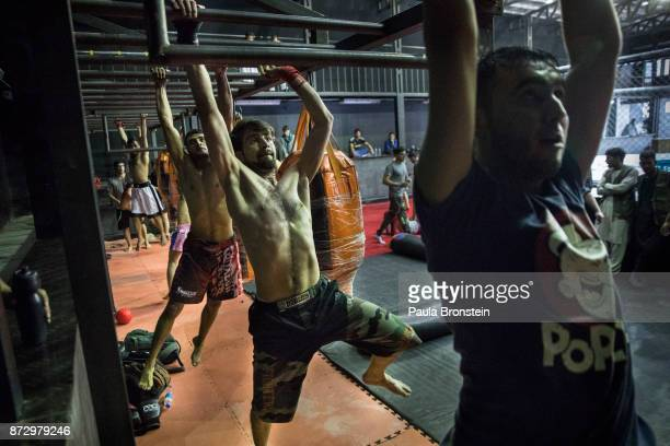 Samir Mukhlis, age 23, trains on the bars during MMA tryouts at the Snow Leopard Fighting Championship gym on May 7, in Kabul. He is considered a...