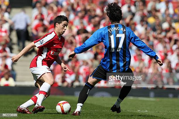 Samir Nasri of Arsenal battles for the ball with Tuncay Sanli of Middlesbrough during the Barclays Premier League match between Arsenal and...