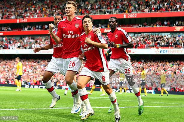 Samir Nasri of Arsenal celebrates after he scored the first goal during the Barclays Premier League match between Arsenal and West Bromwich Albion at...