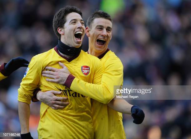 Samir Nasri of Arsenal celebrates scoring to make it 2-0 with team mate Laurent Koscielny during the Barclays Premier League match between Aston...
