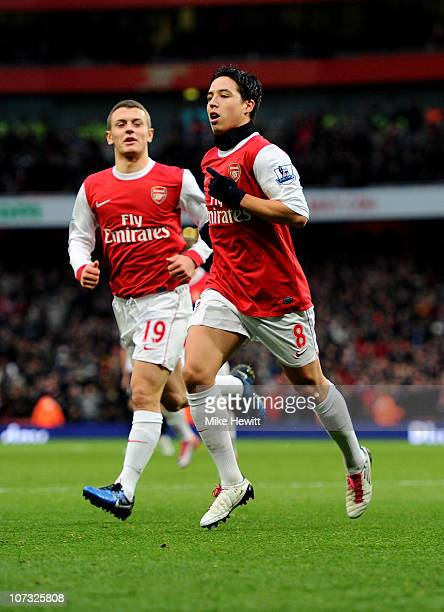 Samir Nasri of Arsenal celebrates with teammate Jack Wilshere after scoring the opening goal during the Barclays Premier League match between Arsenal...