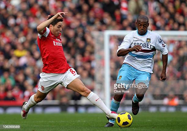 Samir Nasri of Arsenal fights for the ball with Luis Boa Morte of West Ham during the Barclays Premier League match between Arsenal and West Ham...