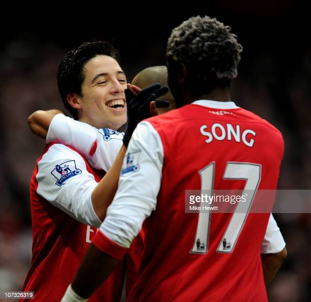 Samir Nasri of Arsenal is congratulated by teammate Alex Song after scoring the opening goal during the Barclays Premier League match between Arsenal...