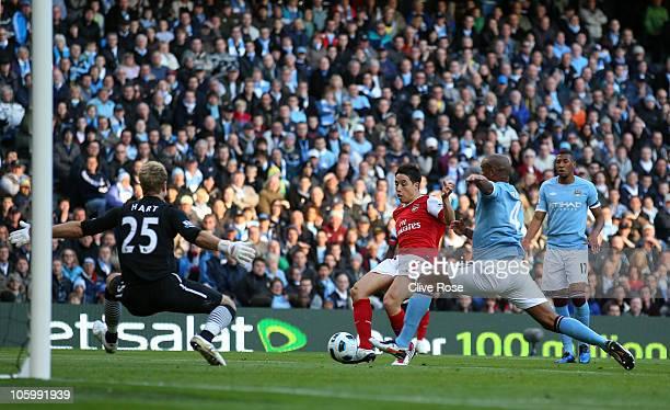 Samir Nasri of Arsenal scores during the Barclays Premier League match between Manchester City and Arsenal at City of Manchester Stadium on October...