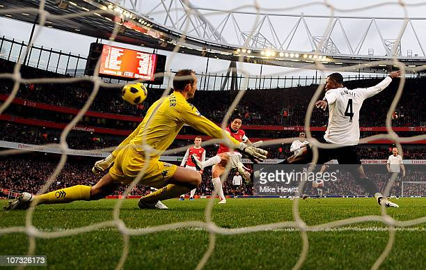 Samir Nasri of Arsenal shoots to score the opening goal past Fulham goalkeeper Mark Schwarzer during the Barclays Premier League match between...