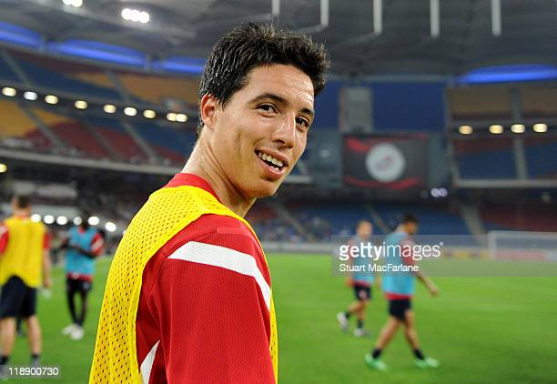 Samir Nasri of Arsenal smiles during an open training session during the club's pre-season Asian tour at the Bukit Jalil Stadium on July 12, 2011 in...