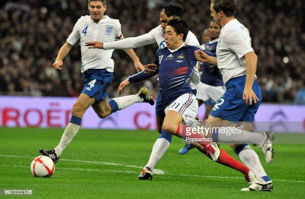 Samir Nasri of France gets away from Steven Gerrard Joleon Lescott and Phil Jagielka of England during an International Friendly at Wembley Stadium...