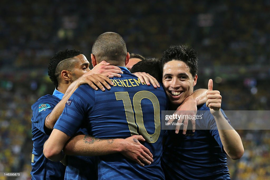 Samir Nasri of France (R) gives the thumbs up as he celebrates Jeremy Menez of France scoring the first goal during the UEFA EURO 2012 group D match between Ukraine and France at Donbass Arena on June 15, 2012 in Donetsk, Ukraine.