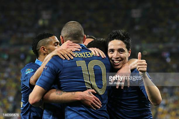 Samir Nasri of France gives the thumbs up as he celebrates Jeremy Menez of France scoring the first goal during the UEFA EURO 2012 group D match...