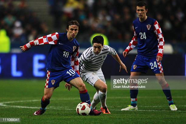 Samir Nasri of France is beaten by Luka Modric of Croatia during the International friendly match between France and Croatia at Stade de France on...