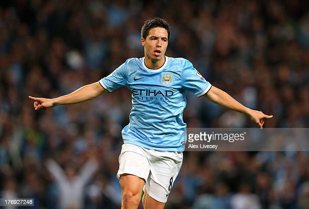 Samir Nasri of Manchester City celebrates after scoring the fourth goal during the Barclays Premier League match between Manchester City and...