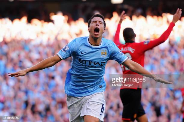 Samir Nasri of Manchester City celebrates as he scores their fourth goal during the Barclays Premier League match between Manchester City and...