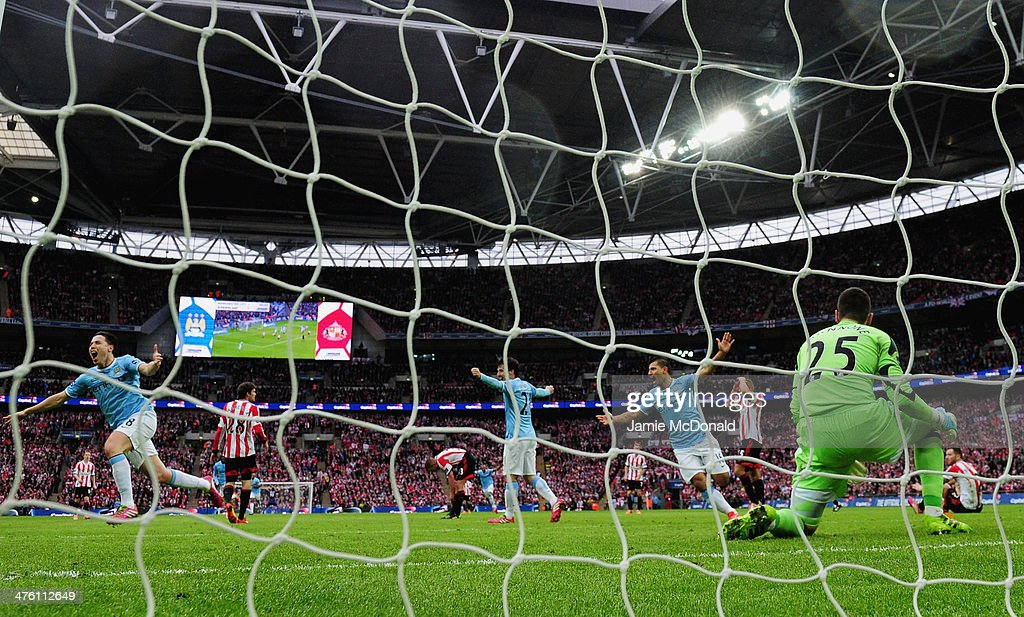 Samir Nasri (L) of Manchester City celebrates his goal during the Capital One Cup Final between Manchester City and Sunderland at Wembley Stadium on March 2, 2014 in London, England.