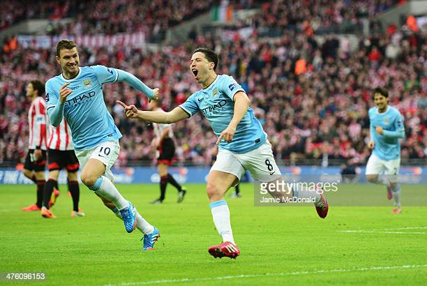 Samir Nasri of Manchester City celebrates his goal with Edin Dzeko during the Capital One Cup Final between Manchester City and Sunderland at Wembley...