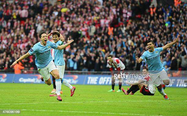 Samir Nasri of Manchester City celebrates his goal with Sergio Aguero during the Capital One Cup Final between Manchester City and Sunderland at...