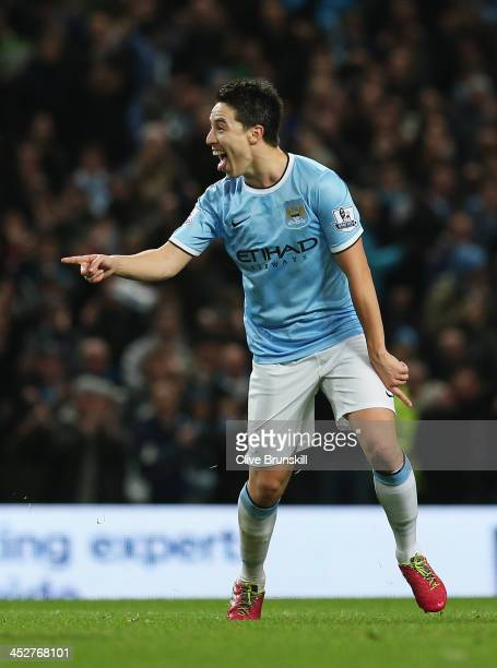 Samir Nasri of Manchester City celebrates his team's second goal during the Barclays Premier League match between Manchester City and Swansea City at...