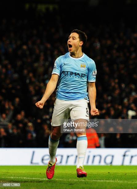Samir Nasri of Manchester City celebrates scoring during the FA Cup Fifth Round match between Manchester City and Chelsea at the Etihad Stadium on...