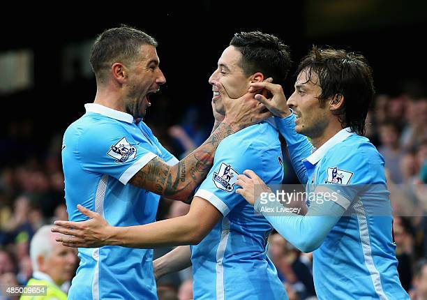 Samir Nasri of Manchester City celebrates scoring his team's second goal with Aleksandar Kolarov and David Silva during the Barclays Premier League...