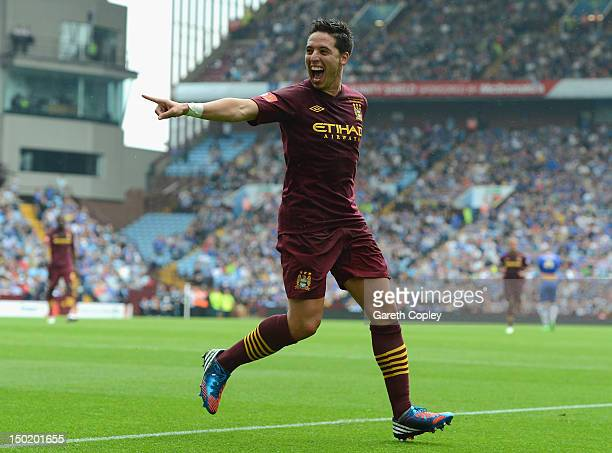 Samir Nasri of Manchester City celebrates scoring his team's third goal during the FA Community Shield match between Manchester City and Chelsea at...