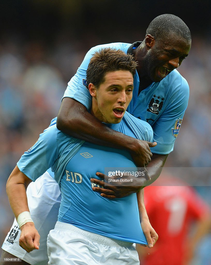 Samir Nasri of Manchester City celebrates scoring his team's third goal with team mate Yaya Toure (R) during the Barclays Premier League match between Manchester City and Southampton at Etihad Stadium on August 19, 2012 in Manchester, England.