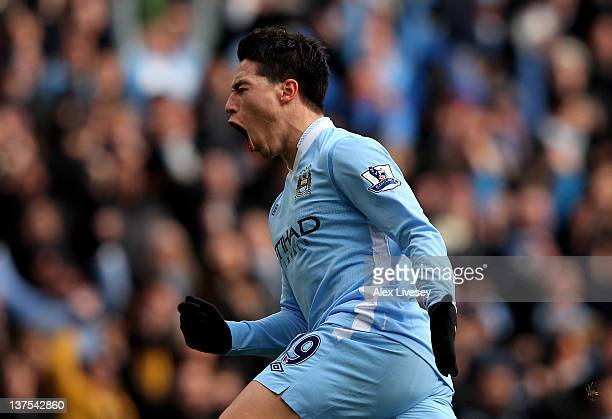 Samir Nasri of Manchester City celebrates scoring the opening goal during the Barclays Premier League match between Manchester City and Tottenham...