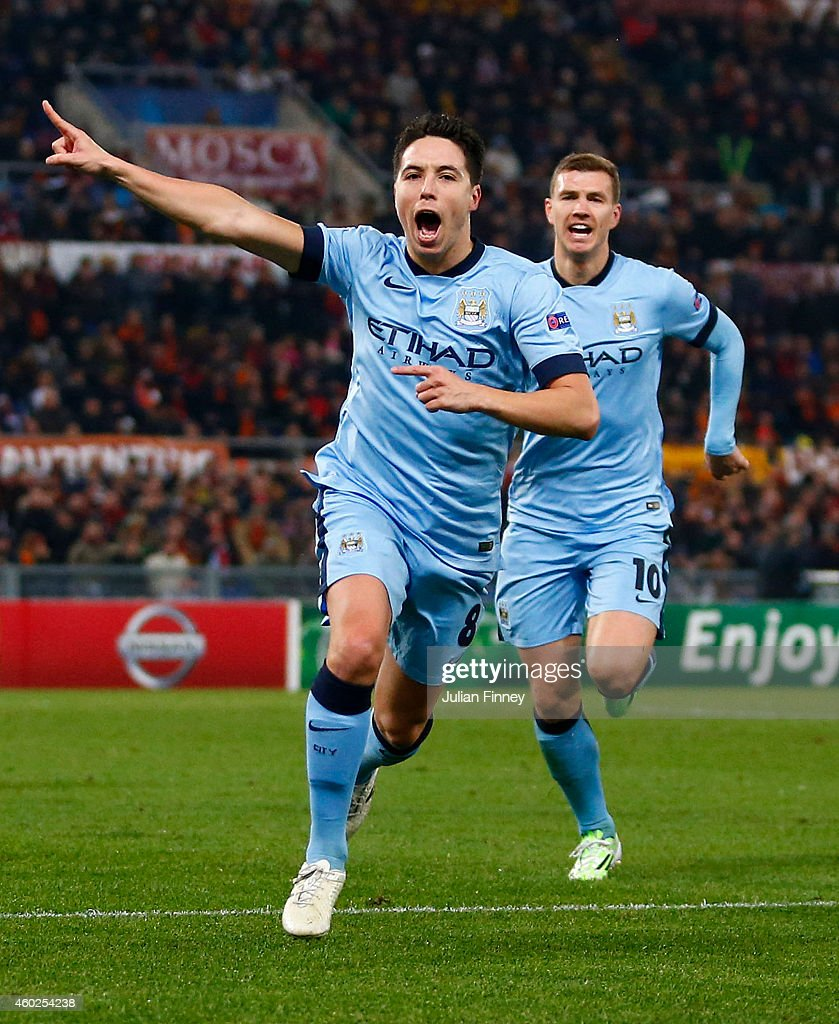 Samir Nasri of Manchester City (8) celebrates with Edin Dzeko as he scores their first goal during the UEFA Champions League Group E match between AS Roma and Manchester City FC at Stadio Olimpico on December 10, 2014 in Rome, Italy.