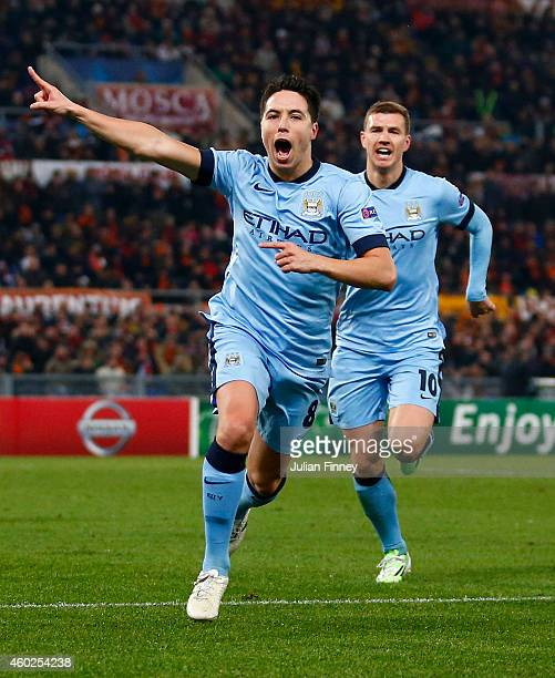Samir Nasri of Manchester City celebrates with Edin Dzeko as he scores their first goal during the UEFA Champions League Group E match between AS...