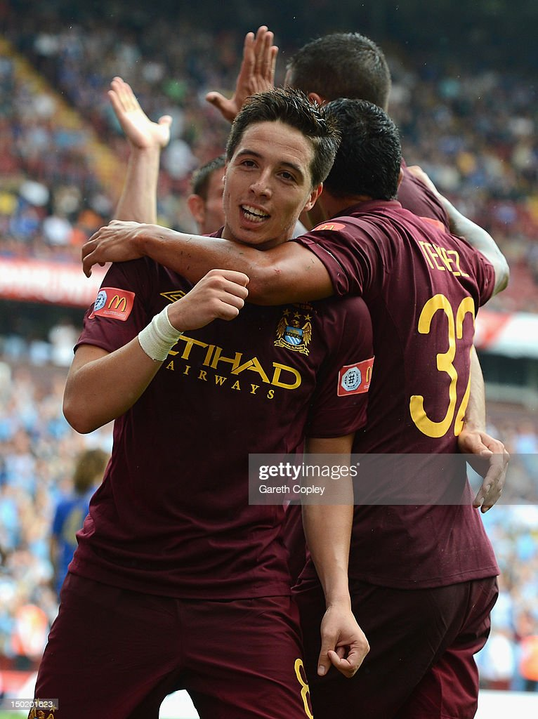 Samir Nasri of Manchester City celebrates with his team mates after scoring his team's third goal during the FA Community Shield match between Manchester City and Chelsea at Villa Park on August 12, 2012 in Birmingham, England.
