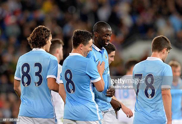 Samir Nasri of Manchester City celebrates with team mate Yaya Toure after scoring a goal during the international friendly match between Melbourne...