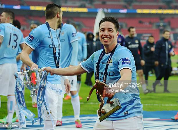 Samir Nasri of Manchester City celebrates with the trophy after the Capital One Cup Final between Manchester City and Sunderland at Wembley Stadium...