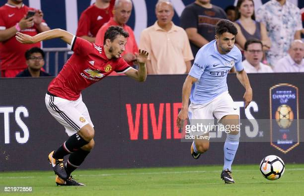 Samir Nasri of Manchester City drives around Matteo Darmian of Manchester United at NRG Stadium on July 20 2017 in Houston Texas