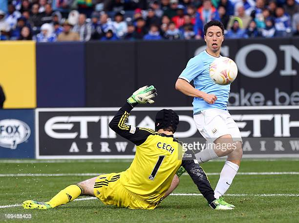 Samir Nasri of Manchester City scores a goal past Petr Cech#1 of Chelsea at Yankee Stadium on May 25 2013 in the Bronx borough of New York City...