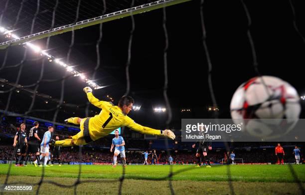 Samir Nasri of Manchester City scores his team's second goal past goalkeeper Matus Kozacik of Plzen during the UEFA Champions League Group D match...
