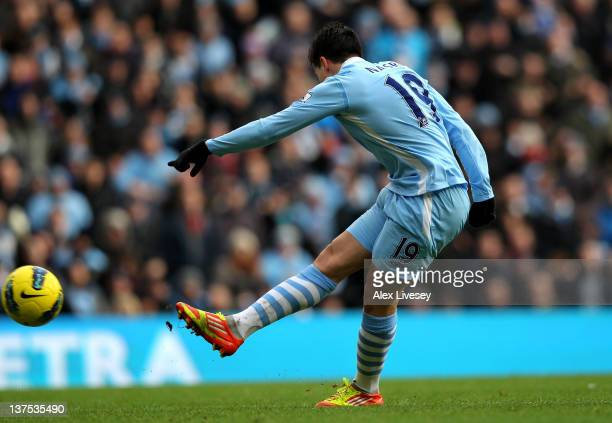 Samir Nasri of Manchester City scores the opening goal during the Barclays Premier League match between Manchester City and Tottenham Hotspur at the...