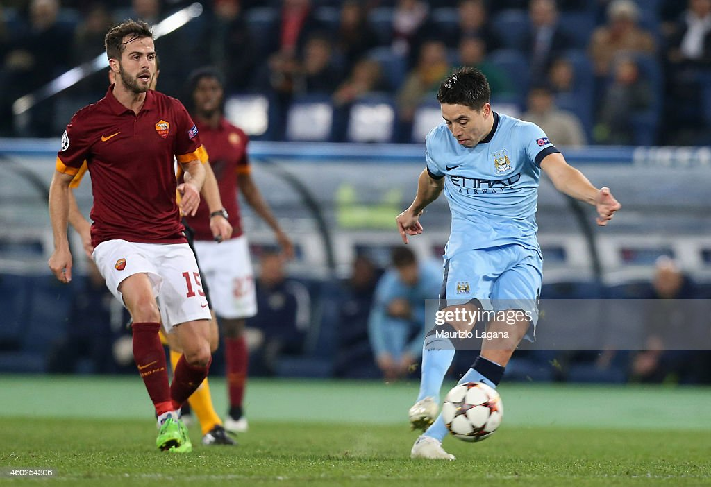 Samir Nasri of Manchester City scores the opening goal during the UEFA Champions League Group E match between AS Roma and Manchester City FC on December 10, 2014 in Rome, Italy.