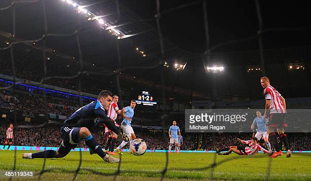 Samir Nasri of Manchester City scores their second goal past Vito Mannone of Sunderland during the Barclays Premier League match between Manchester...
