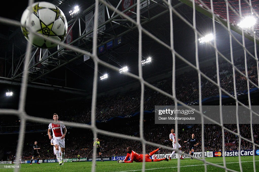 Samir Nasri of Manchester City shoots and scores the first goal of the game during the Group D UEFA Champions League match between AFC Ajax and Manchester City FC at Amsterdam ArenA on October 24, 2012 in Amsterdam, Netherlands.