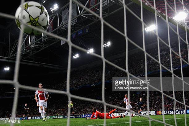 Samir Nasri of Manchester City shoots and scores the first goal of the game during the Group D UEFA Champions League match between AFC Ajax and...