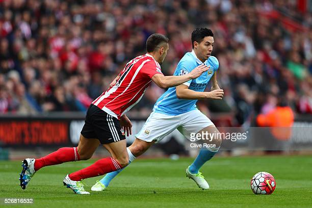 Samir Nasri of Manchester City takes on Dusan Tadic of Southampton during the Barclays Premier League match between Southampton and Manchester City...