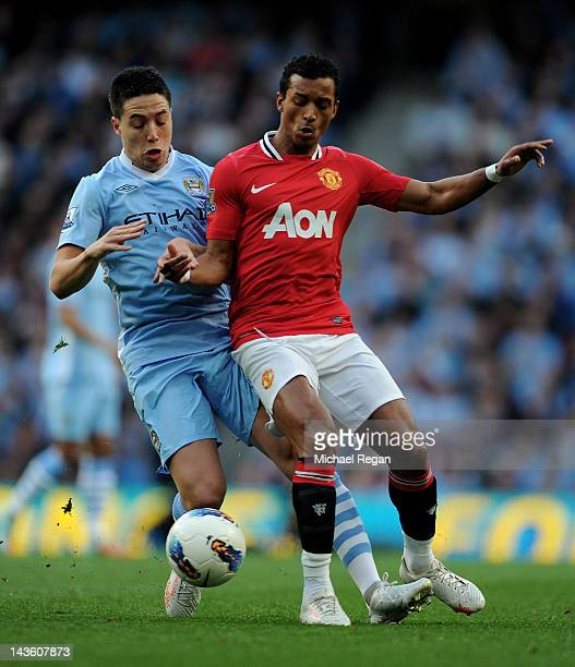 Samir Nasri of Manchester City tangles with Nani of Manchester United during the Barclays Premier League match between Manchester City and Manchester...